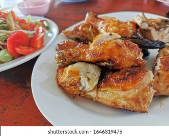Thai style grilled chicken in white dish