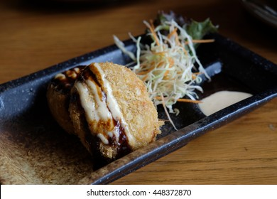 Thai style Korokke. made from sweet potato. Misoya, Thonglor, Thailand. Korokke is the Japanese name for a deep-fried dish originally related to a French dish, the croquette.