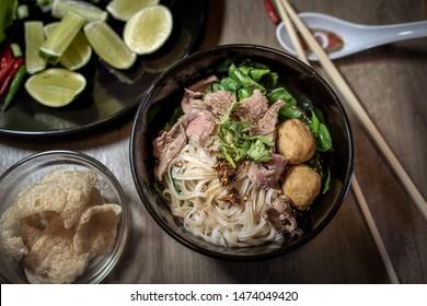 Thai style noodle blood soup,boat noodle,delicious dish,famous Thai noodle soup. Thai peoples call Boat Noodles. Close up or selective focus