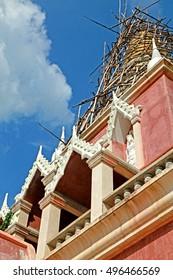 Thai style pagoda on blue sky