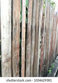 Thai style picketfence made of old wood, seized with tack and screws.