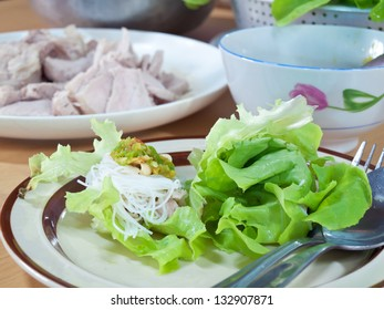 Thai style salad with leaf lettuce, noodle, slice boiling pork and spicy sauce