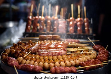 Thai style sausage grilling on stove at night market , Chiang mai , Thailand