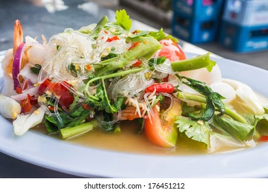 thai style seafood spicy salad with vegetable served in restaurant