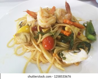 Thai style Spaghetti seafood on white dish
