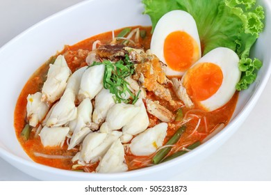 Thai style, spicy hot and sour soup with glass noodles, crab and Medium-boiled egg topping, tom yum and flavoring on white background