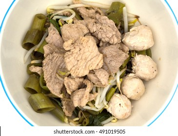 Thai style stewed sliced pork and pork meatballs dry soup with morning glory and bean sprout