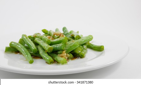Thai style stir fried green beans on white plate. (3)