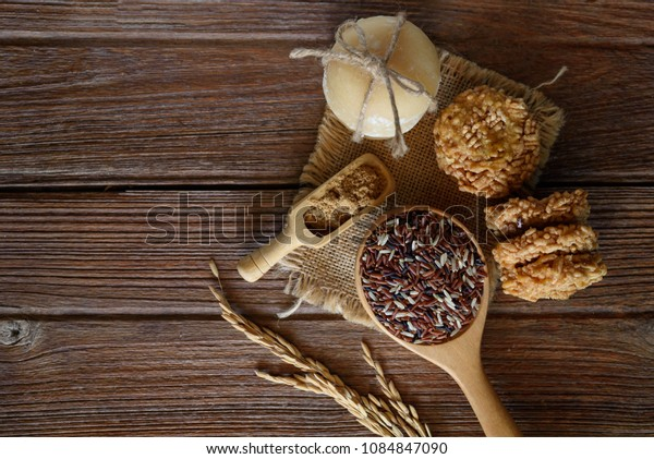 Thai sweet crispy rice cracker with cane sugar on wooden background.