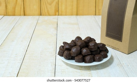 Thai sweetmeat made of flour, egg and sugar, Thai traditional dessert, Kanom Ping, Flour coated chocolate on plate