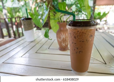 Thai tea mix with cocoa on wooden table