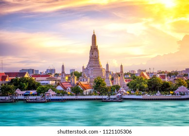 Thai Temple at Chao Phraya River Side, Sunset at Wat Arun Temple in Bangkok Thailand. Wat Arun is a Buddhist temple in Thon Buri District of Bangkok,Is among the best known of Thailand's landmarks