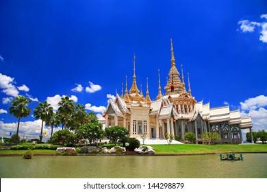 Thai temple named Wat Sorapong near the pond against blue sky in  Nakhon Ratchasima or Korat, Thailand