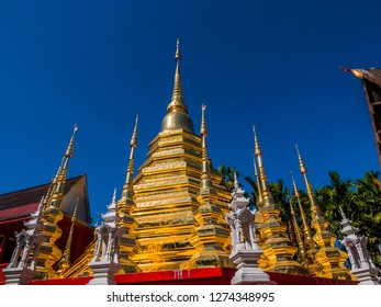 Thai temple rising to the blue sky. The beautiful nice gold border is a real sensation. A lot of tourists coming to there.