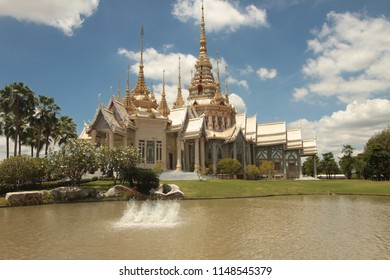 Thai temple surrounded by pond in Nakhonratchasima, Thailand. Wat Non Kum(sorapong)Buddhist Temple  Nakhon Ratchasima  .Beautiful Thai style church at Nakhonratchasima province, Thailand.