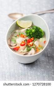 thai tom kha gai soup in a bowl