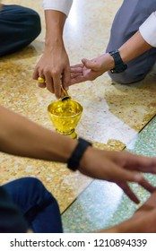 Thai tradition, pouring water is an act of praying for deceased ones whom