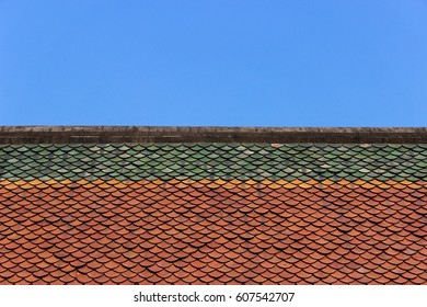 Thai tradition Temple Roof-Tile. Architecture view. Green yellow orange And blue. Abstract.
