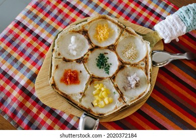 Thai traditional dessert, local name is Khanom Khrok. It is Local Thai food, Kind of Thai sweetmeat, sweetmeat. kind, dessert. It cooks in special pan with small pit. A pan put on bamboo table.