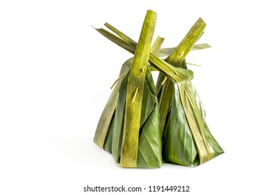 Thai traditional dessert well known as khanom sai sai, or steamed flour with sweet coconut stuff, on white background