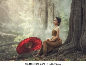Thai traditional dress;Asian woman wearing typical (traditional) Thai dress, vintage original Thailand attire , identity culture of Thailand