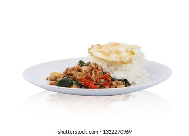 Thai traditional food .Stir- fried minced pork and basil on rice and fried egg isolated on white background. With clipping path.