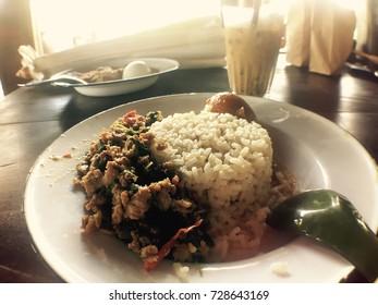 Thai traditional food, stir fried pork with basil,Warm tone color