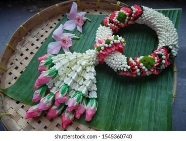Thai traditional garlands known as Malai. They are made by stringing together various flower combinations usually jasmine buds ,orchid ,crown flowers and roses.