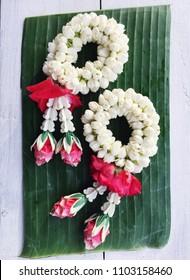 Thai traditional jasmine garland on banan leaf