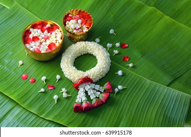 Thai traditional jasmine garland.symbol of Mother's day in thailand on Banana leaf.