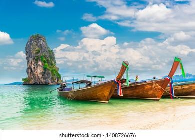 Thai traditional longtail boat on natural sea beach waiting for traveler, Ao Nang beach Krabi, Landmark tourist travel Phuket Thailand summer holiday vacation trips, Tourism beautiful destination Asia
