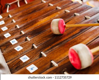 Thai traditional music instrument call Ranat Ek with mallet Ranat Ek is a Thai musical instrument in the percussion family It is used as a leading instrument in the piphat ensemble.