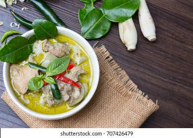 Thai Traditional And Popular Food, Chicken Green Curry on wooden background.