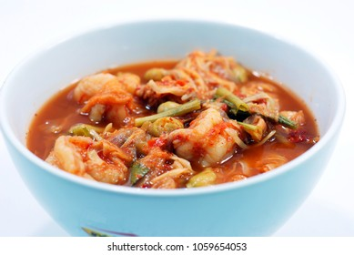 Thai traditional sour and spicy soup with shrimps and nutritional vegetables,it is a delicious hot soup.