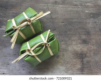 Thai traditional sticky rice dessert in banana leaf packaging