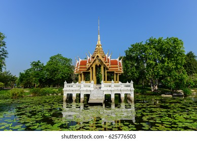 Thai traditional style buddhist temple in a lotus pond