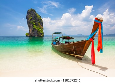 Thai traditional wooden longtail boat and beautiful sand beach at Koh Poda island in Krabi province. Ao Nang, Thailand.