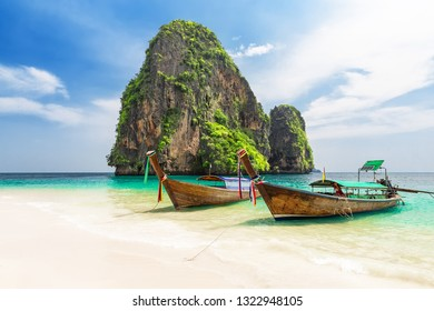 Thai traditional wooden longtail boat and beautiful sand Ao Phra Nang Beach in Krabi province. Ao Nang, Thailand.