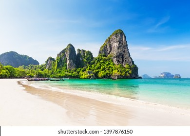 Thai traditional wooden longtail boat and beautiful sand Railay Beach in Krabi province. Ao Nang, Thailand.