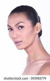 Thai Trans Gender Model with Clean Skin Natural Nude Make Up with sharp bone in Studio Lighting on White Background
