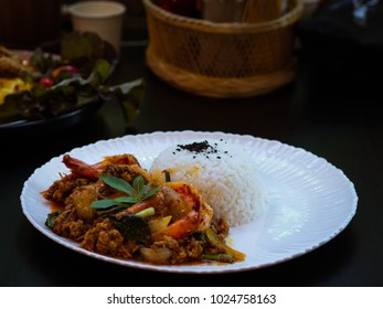 Thai wok fried pork with spicy red chilli sauce a la cart serve with Jasmine rice made order to cooked. Thai Food for Your Meal During Your Day.