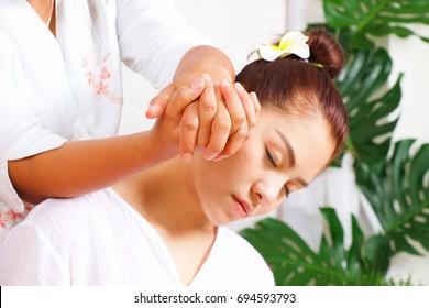 Thai woman is having Thai massaging in spa.