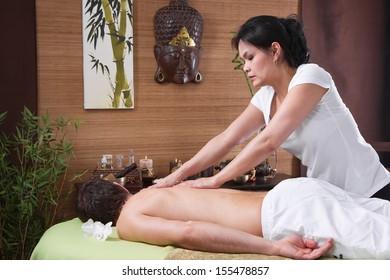 Thai woman making massage to a man