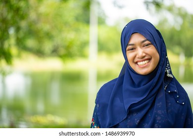Thai woman muslim portrait smile and happy in the outdoor.