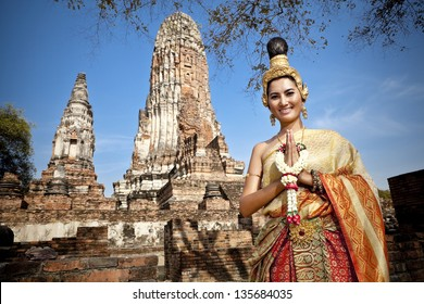 Thai Woman performing typical Thai dance with traditional Thai style temple background, identity culture of Thailand