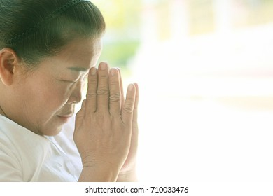 Thai woman praying hands