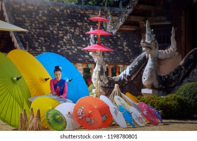 Thai Woman In Traditional Costume Of north Thailand painting umbrella vintage style,chiangmai Thailand