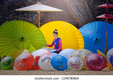 Thai Woman In Traditional Costume of northThailand painting umbrella vintage style,chiangmai Thailand