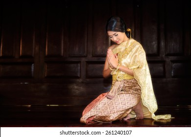 Thai Woman In Traditional Costume Of Thailand in ancient house at Ayutthaya