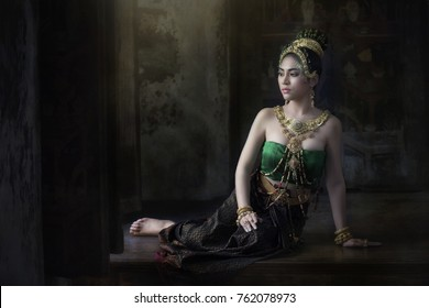 Thai Woman in Traditional Costume of Thailand. Beautiful Thai girl in traditional dress costume in Choeng Tha as Thai temple where is the public place, Ayutthaya province
